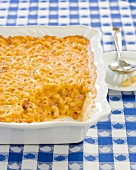 Tomato Macaroni and Cheese Casserole in Baking Dish with Scoop Removed