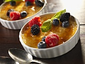 Creme Brulee in with fresh berries