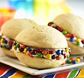 Vanilla Whoopie Pies with Cream Filling and Colorful Candy Coated Chocolates