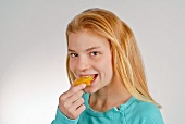 Girl Eating a Slice of Star Fruit