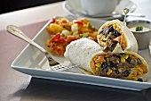 Breakfast Burrito Served with Potatoes with Green and Red Bell Peppers