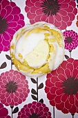 Cheese Filled Danish with Icing on Floral Background