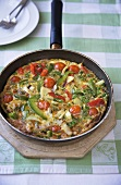 Tortilla Topped with Fresh Vegetables and Cheese Cooked in a Skillet