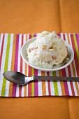 Small Dish of Marmalade Frozen Yogurt; Spoon