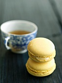 Two Lemon Macaroons; Stacked with a Cup of Tea