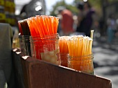 Jars of Orange and Lemon Honey Sticks at a Farmers Market in Seattle Washington