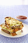 Roast Beef, Cheese and Pesto Panini; Halved and Stacked; Dipping Sauce