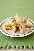 Two Star Cookies with Pistachios on a Plate