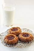 Peanut Butter and Jelly Cookies with a Glass of Milk