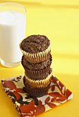 Stacked Bran Muffins with a Glass of Milk