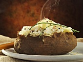 Steaming Baked Potato with Butter and Chives