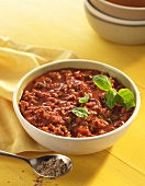 Bowl of Turkey Chili on a Yellow Table