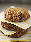 Stacked Oatmeal Raisin Cookies Stacked; Divided by Yellow Striped Paper