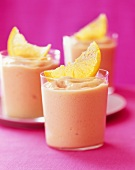 Orange smoothies with fresh orange wedges