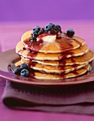 Stack of Pancakes with Butter and Blueberry Sauce