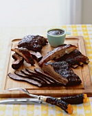 Grilled Barbecue Ribs and Brisket on a Cutting Board