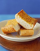 Three Pieces of Garlic Bread on a Small Plate