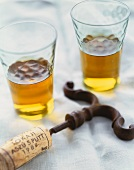 Two Glasses of White Wine with a Wine Cork on a Cork Screw