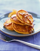 Plate of Mini Pumpkin Pancakes with Maple Syrup