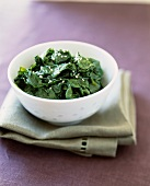 Bowl of Wilted Spinach with Sesame Oil and Sesame Seeds