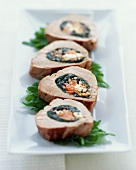 Roasted Stuffed Pork Tenderloin; Sliced on a Platter