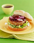 Pork Burger with Red Onion and Lettuce on a Roll