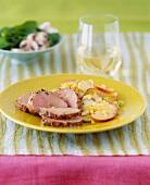 Plate of Sliced Pork Tenderloin with a Side of Apple Salad