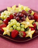 Fresh Fruit Platter with Red and Green Grapes, Star Fruit and Strawberries