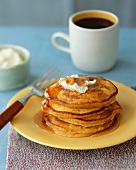 Stack of Pumpkin Pancakes with Butter and Maple Syrup; Cup of Coffee