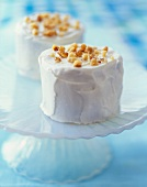 Mini Carrot Cakes with White Frosting and Nut Topping