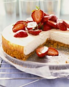 Cheesecake Topped with Sliced Strawberries; Slice Removed