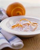 Fresh Orange Peel in a Bowl of Sugar