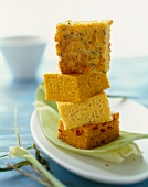 Assorted Pieces of Corn Bread; Stacked