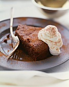 Piece of Flourless Chocolate Cake with Whipped Cream; Dusted with Cocoa Powder
