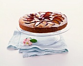Whole Plum Tart on a Cake Stand