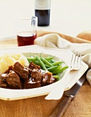 Beef Stew with Mashed Potatoes and Green Beans in a Dish