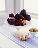 Fresh Plums on a Pedestal Dish with Brown Sugar and Fresh Ginger