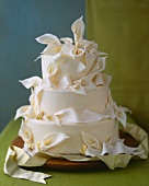 White Wedding Cake Decorated with White Calla Lilies