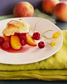 A Serving of Peach and Raspberry Slump in a White Plate