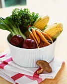 Bowl of Fresh Fruit and Vegetables; On a Folded Dish Cloth