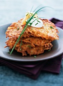 Stack of Potato Pancakes with Sour Cream and Chives
