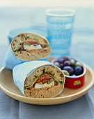 Tuna, Anchovy, Caper and Egg Sandwich; Wrapped in Paper; Bowl of Olives