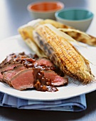Sliced Beef Brisket with Gravy and Corn on the Cob