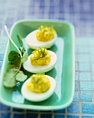 Three Deviled Eggs on a Green Platter