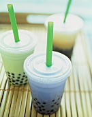 Three Assorted Tapioca Drinks in Plastic Take Out Cups with Straws
