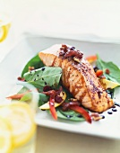 Seasoned Salmon Fillet Served Over a Baby Spinach Salad with Balsamic Dressing