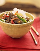 Black Bean Beef Stir Fry in a Bowl with Rice; Chopsticks