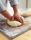 Man Kneading Dough on a Floured Surface