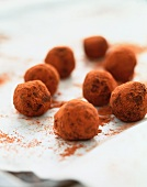 Homemade chocolate truffles dusted with cocoa powder