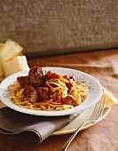 Plate of Spaghetti with Meatballs and Sausages in Tomato Sauce